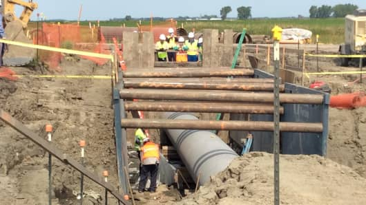 Crews from Enbridge Energy Partners inspect a crude oil pipeline in Thief River Falls, Minnesota.