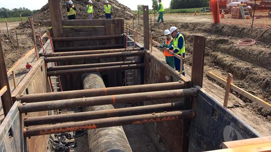 Crews from Enbridge Energy Partners inspect a crude oil pipeline in Thief River Falls, Minn.