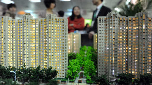 People at a real estate trade fair in Beijing, China.