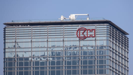 The logo for Cheung Kong is displayed atop the Cheung Kong Center in Hong Kong, China.