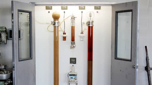 The reactor room at Industry City Distilling, where a mix of beet sugar and water passes through yeast beads in each of the two bioreactors.