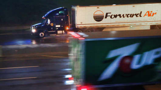 Truck drivers navigate a rain-covered highway on the outskirts of Chicago, in Hinsdale, Ill.