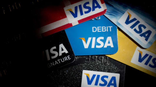 A Visa debit card is shown at the center of other debit and credit cards in Washington.