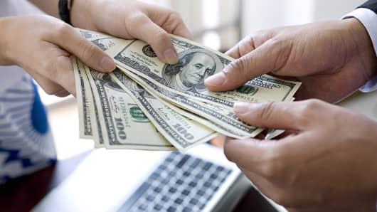 Cash transaction retail consumer spending