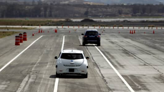 The Nissan Autonomous Drive Leaf electric vehicle, left, is test driven during the Nissan Motor Co. 360 event in Irvine, California.