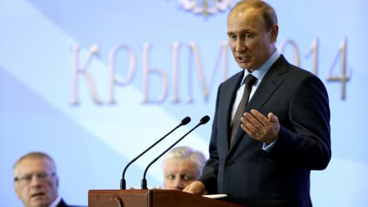 Russian President Vladimir Putin delivers a speech near Yalta, Crimea, Aug. 14, 2014.