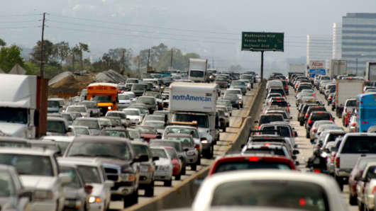 Friday afternoon commuters clog the Los Angeles area freeways.