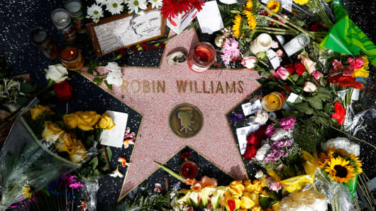 Flowers are seen on the late Robin Williams' star on the Hollywood Walk of Fame in Los Angeles, California August 12, 2014.