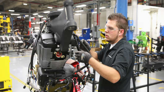 A worker builds a Victory Cross Country motorcycle at the Polaris Industries factory in Spirit Lake, Iowa.