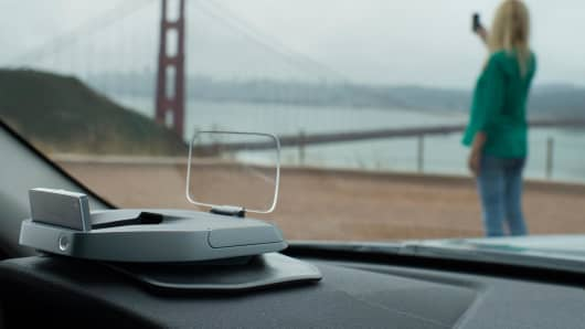 Navdy transparent Head-Up Display (HUD) projects information as if it's floating six feet.