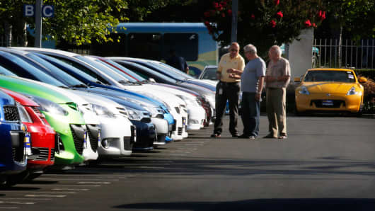 Customers shop for used vehicles at a CarMax in Burbank, Calif.