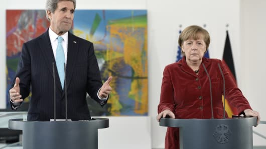 United States Secretary of State John Kerry attends a press conference with German Chancellor Angela Merkel at the German Federal Chancellery on January 31, 2014 in Berlin, Germany.