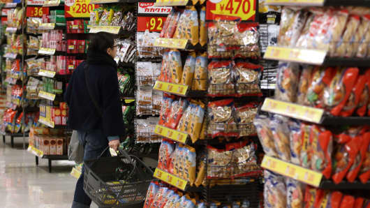 A customer shops in a Seiyu GK supermarket, a discount chain owned by Wal-Mart Stores Inc in Tokyo, Japan.