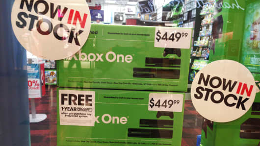Xbox One boxes in the window of a Game Stop store