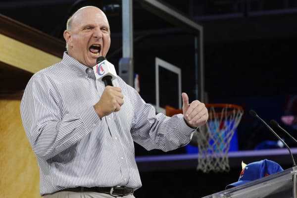 Steve Ballmer, former chief executive officer of Microsoft Corp., speaks to fans as he is introduced as the new owner of the Los Angeles Clippers in Los Angeles, California on Aug. 18, 2014.
