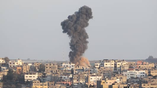 Smoke rises following what witnesses said was an Israeli airstrike in Gaza August 19, 2014.