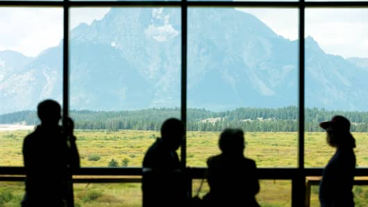 Mount Moran in Grand Teton National Park is seen through a window at the Jackson Lake Lodge in Moran, Wyoming.