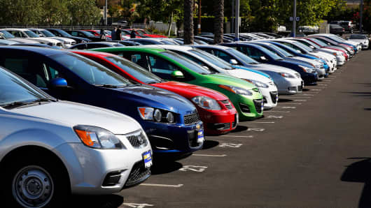 Used cars are displayed outside of a CarMax dealership in Burbank, California, on June 17, 2014.