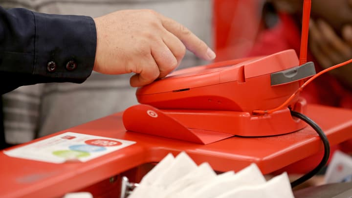 A customer uses a credit card scanner at a Target store in Miami.
