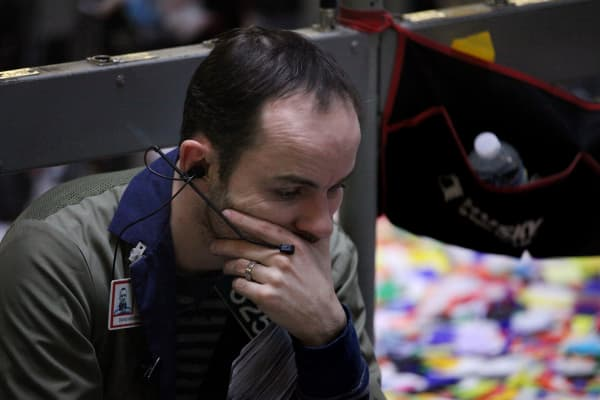 A trader sits on the the financial floor at the CME Group Inc.'s Chicago Board of Trade in Chicago, Illinois, U.S..