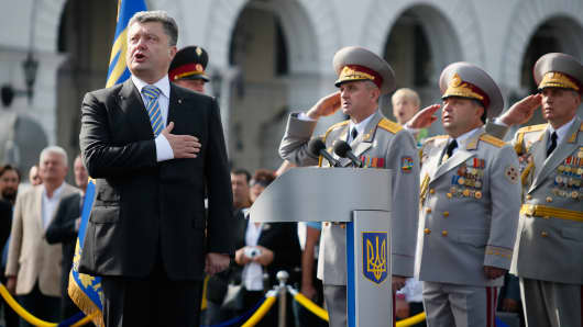 Ukraine's President Petro Poroshenko sings the national anthem during the Independence Day military parade, in Kiev, Aug. 24, 2014.
