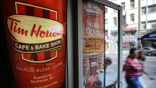 Burger King is in talks to acquire Canadian chain Tim Hortons.
