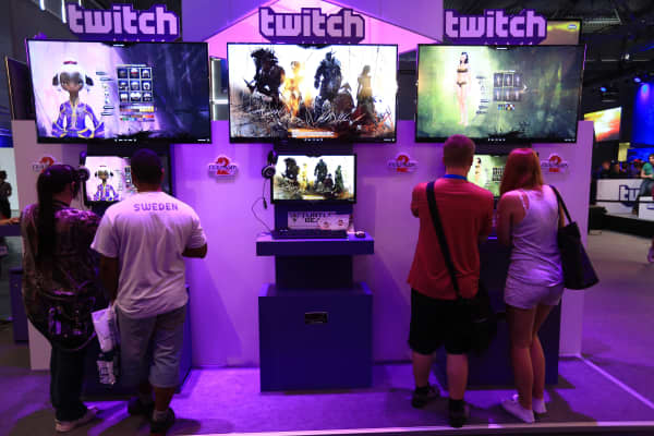 Visitors stream online computer games on the Twitch Interactive stand at Gamescom video games trade fair in Cologne, Germany.