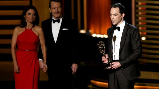 Actress Julia Louis-Dreyfus (L), actor Bryan Cranston and winner of the Outstanding Lead Actor in a Comedy Series award for 'The Big Bang Theory' Jim Parsons on stage during the 66th Annual Primetime Emmy Awards on August 25, 2014.