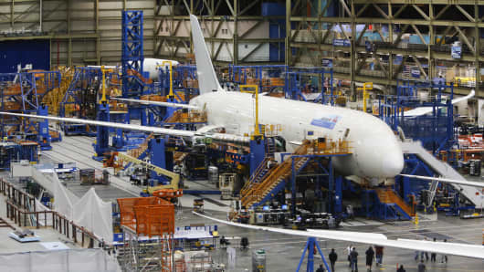 Workers assemble a Boeing 787 Dreamliner at the Boeing Everett Factory in Everett, Washington.