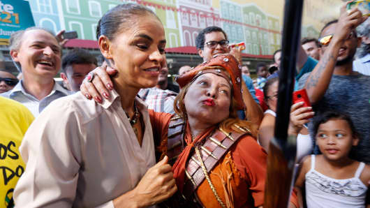 Brazil's Socialist Party presidential candidate Marina Silva, left, attends a rally campaign in Sao Paulo August 24, 2014.