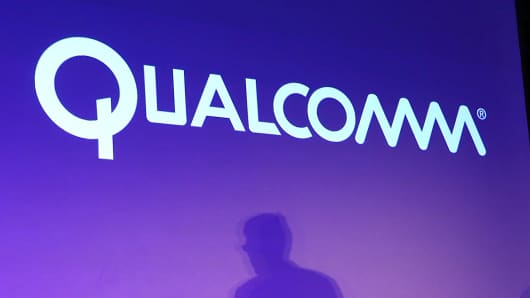 Qualcomm signage and a shadow of CEO Steve Mollenkopf
