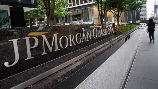A woman walks past JP Morgan Chase's corporate headquarters in New York.