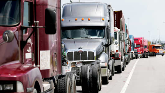 Trucks line up to enter Port Everglades on July 30, 2014 in Fort Lauderdale, Florida.