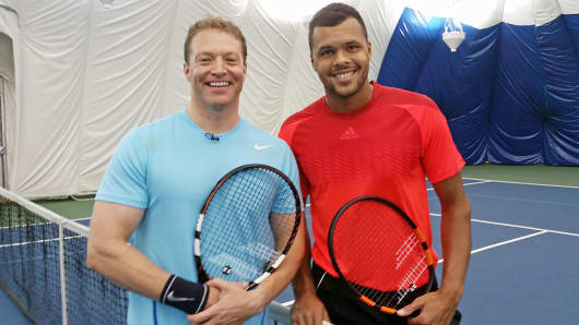 Jo-Wilfried Tsonga tries out Babolat's Play smart racket on the court with CNBC's Robert Frank.