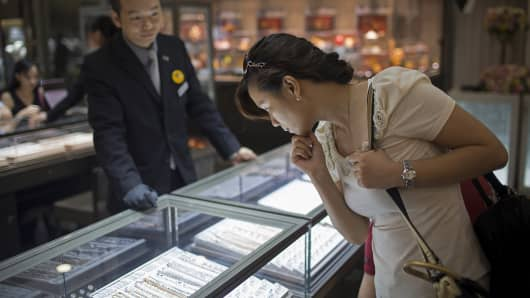 A customer looks at jewelry inside a store in Macau, China.