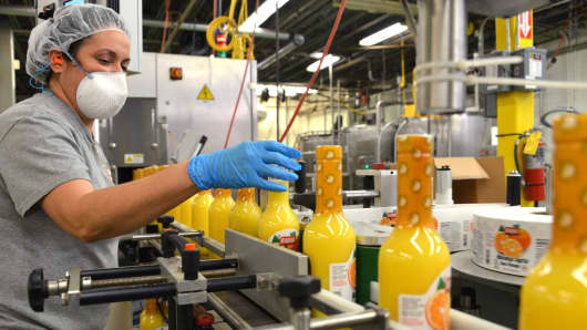 "An employee checks labels of ""Naranja Agria"" on the bottling line at the Badia Spices factory in Doral, Florida."