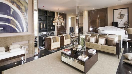 The penthouse features five reception and entertaining rooms. This one has a baby grand piano.