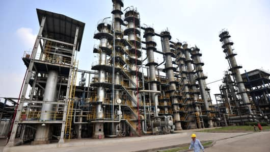 A worker walking by at an oil refinery of China's Sinopec, in Wuhan, central China's Hubei province.
