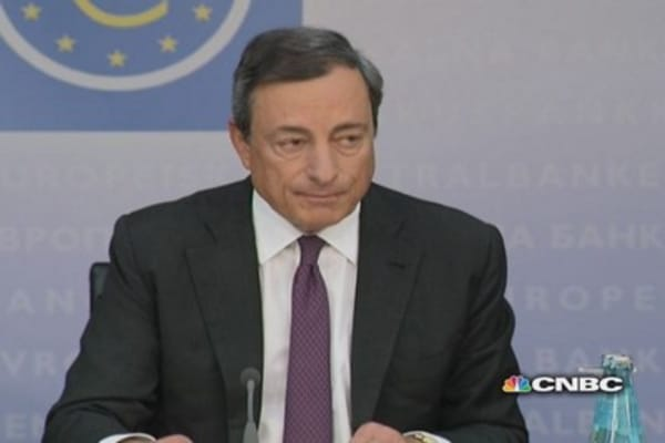 ECB cuts rates, starts ABS program