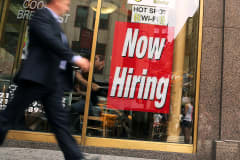 """A """"now hiring"""" sign at a fast food restaurant in New York."""