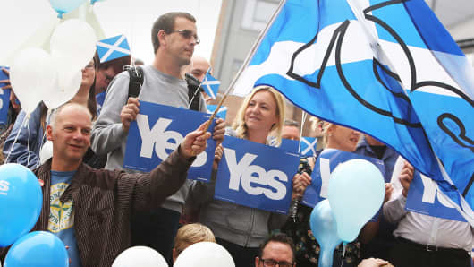 Pro-Scottish independence 'Yes Scotland' campaign supporters await the start of a press event on September 8, 2014 in Glasgow, Scotland.