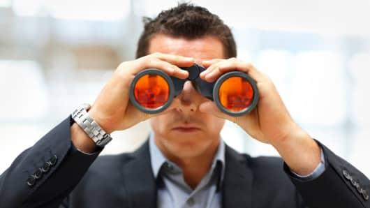 Businessman with binoculars