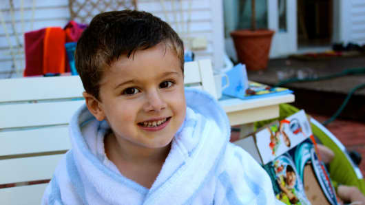 Eytani Ganot, a 4-year-old with Duchenne muscular dystrophy, has inspired his father, Ilan, to leave his hedge fund job and form a for-profit company working for a cure for the muscle-wasting disease.
