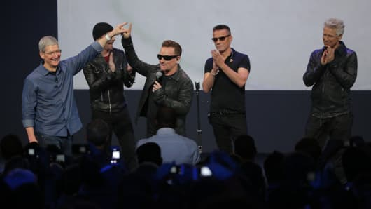 Tim Cook with U2 at the Apple event on Sept. 9, 2014.