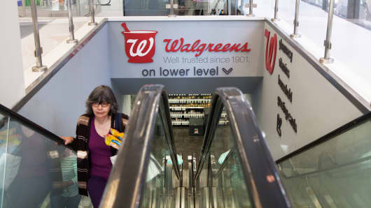 A woman on an escalator in a Walgreens store in New York.