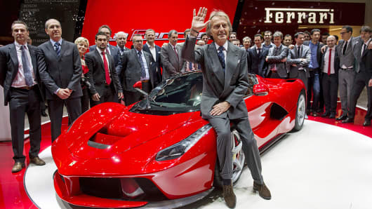 Luca Cordero di Montezemolo waves after the introduction of  La Ferrari during the 83rd Geneva Motor Show.