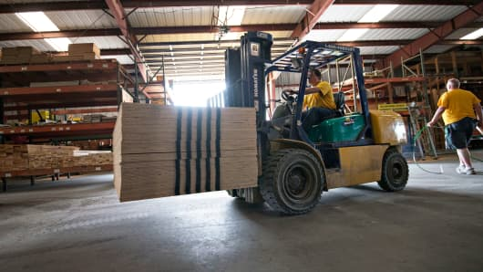 A stack of plywood is moved with a forklift in the warehouse at Maze Lumber in Peru, Illinois.
