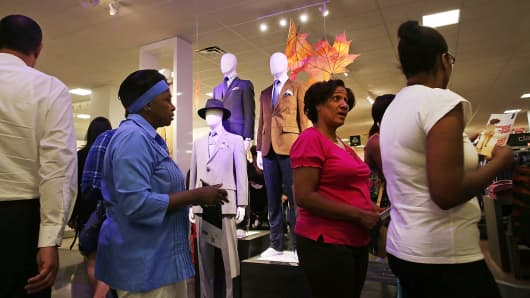 Customers shop at a newly opened J.C. Penney store at the Gateway Center Mall in Brooklyn.