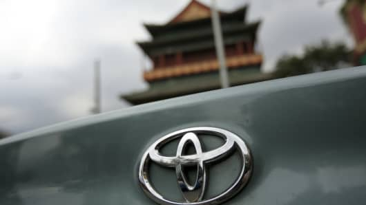 The Toyota Motor logo is displayed on a vehicle in Beijing, China.