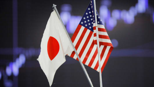 U.S. and Japanese flags are displayed at a foreign exchange firm in Tokyo.